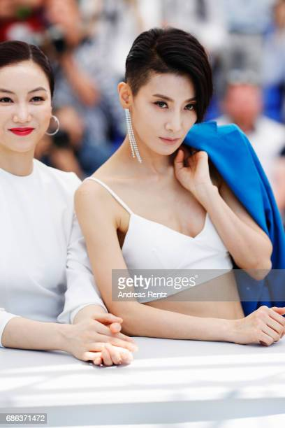 Actresses Kim Okvin and Kim Seo Hyung attend the The Villainess photocall during the 70th annual Cannes Film Festival at Palais des Festivals on May...