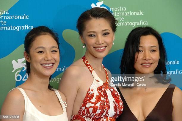 Actresses Kong Wei Zhou Yun and Joan Chen at the photocall of the film Taiyang Zhaochang Shengqi during the 64th Venice Film Festival