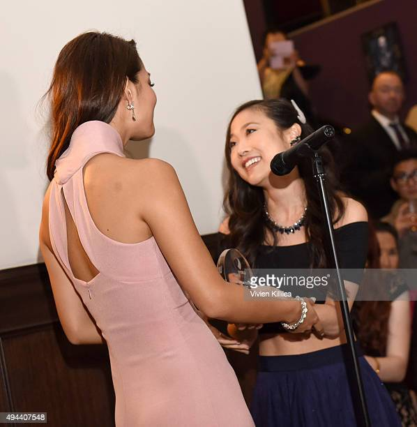 Actresses Krista Marie Yu presents actress Sumire Matsubara with the Rising Star Award at the Asian World Film Festival Opening Night Red Carpet...