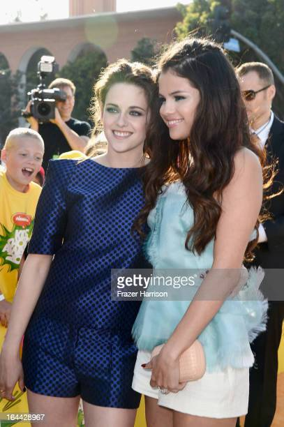 Actresses Kristen Stewart and Selena Gomez arrive at Nickelodeon's 26th Annual Kids' Choice Awards at USC Galen Center on March 23 2013 in Los...
