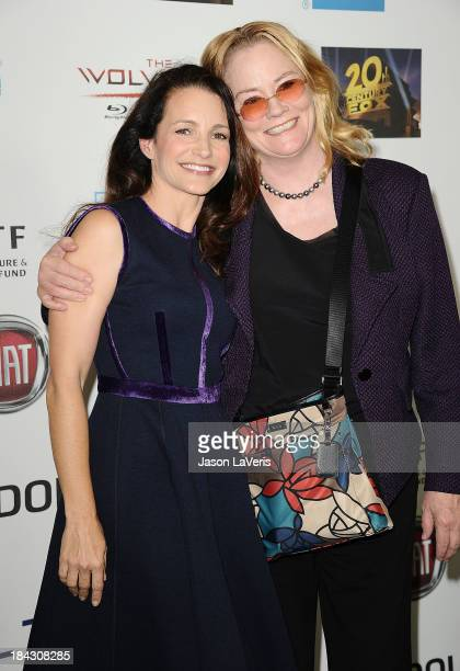 Actresses Kristin Davis and Cybill Shepherd attend Hugh Jackman's 'One Night Only' benefitting the MPTF at Dolby Theatre on October 12 2013 in...