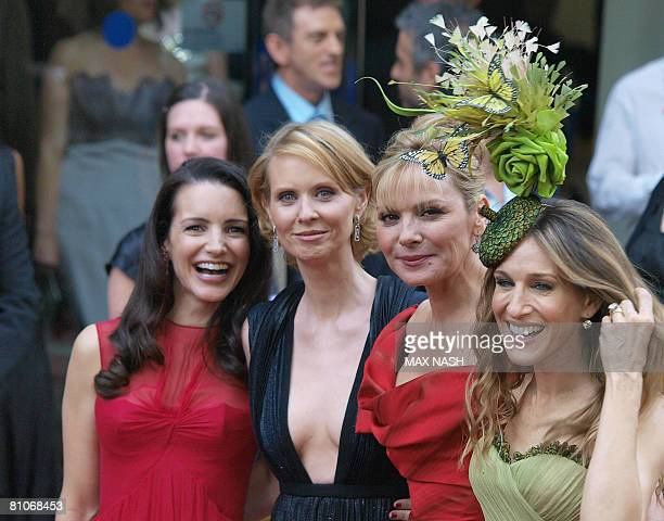 Actresses Kristin Davis, Cynthia Nixon, Kim Catrall, and Sarah Jessica Parker pose for the photographers after arriving in London's Leicester Square...