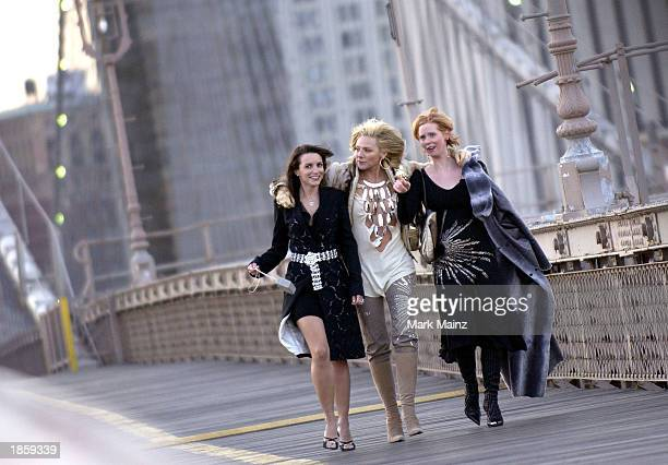 Actresses Kristin Davis Kim Cattrall and Cynthia Nixon shoot a promotional video for the hit HBO series 'Sex and the City' on Brooklyn Bridge March...