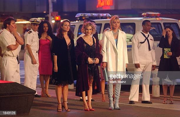 Actresses Kristin Davis Sarah Jessica Parker and Kim Cattrall appear on the set of the HBO television show Sex in the City May 17 2002 at Times...