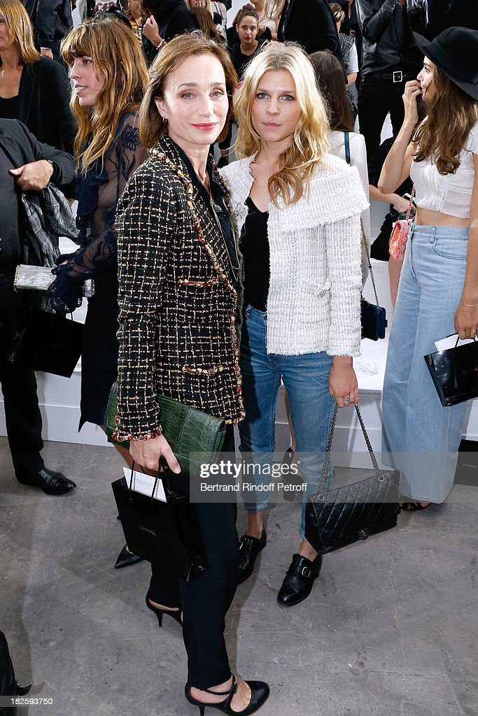 Actresses Kristin Scott Thomas and Clemence Poesy attend the Chanel show as part of the Paris Fashion Week Womenswear Spring/Summer 2014, held at Grand Palais on October 1, 2013 in Paris, France.