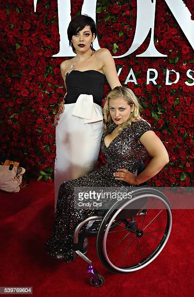 Actresses Krysta Rodriguez and Ali Stroker attend the 70th Annual Tony Awards at The Beacon Theatre on June 12 2016 in New York City