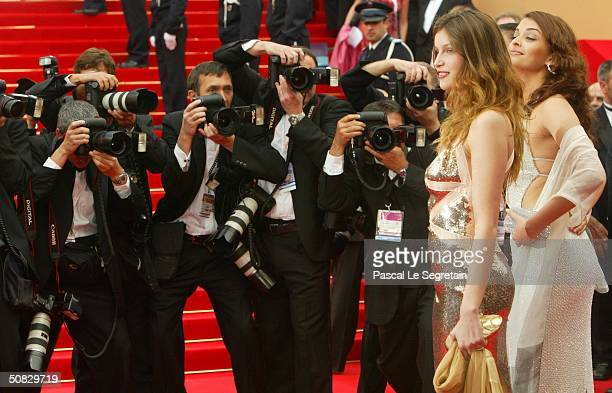 Actresses Laetitia Casta and Aishwarya Rai are surrounded by the media during red carpet arrivals for the 57th Cannes Film Festival Opening Ceremony...