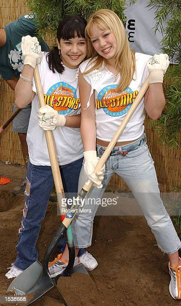 Actresses Lalaine and Hilary Duff of Dinsey's Lizzie McGuire volunteer to refurbish the grounds at the Boys and Girls Club of Burbank April 27 2002...