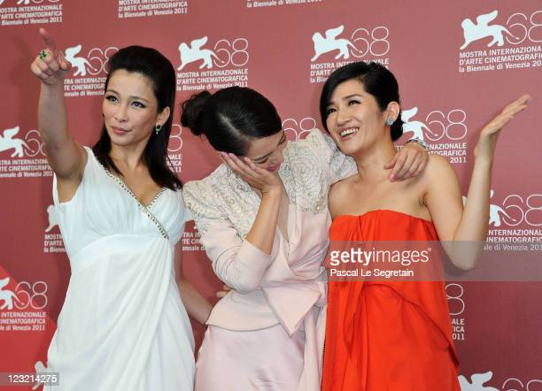 Actresses Landy Wen Vivian Hsu and Lo Meiling pose during the Warriors Of The Rainbow Seediq Bale photocall at the Palazzo Del Cinema during the 68th...