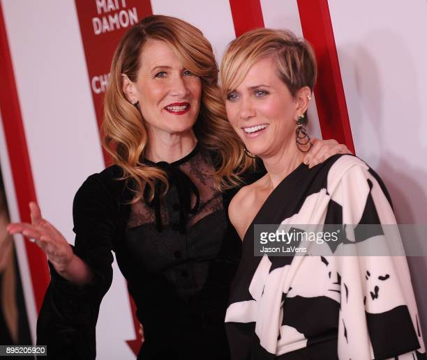 Actresses Laura Dern and Kristen Wiig attend the premiere of 'Downsizing' at Regency Village Theatre on December 18 2017 in Westwood California