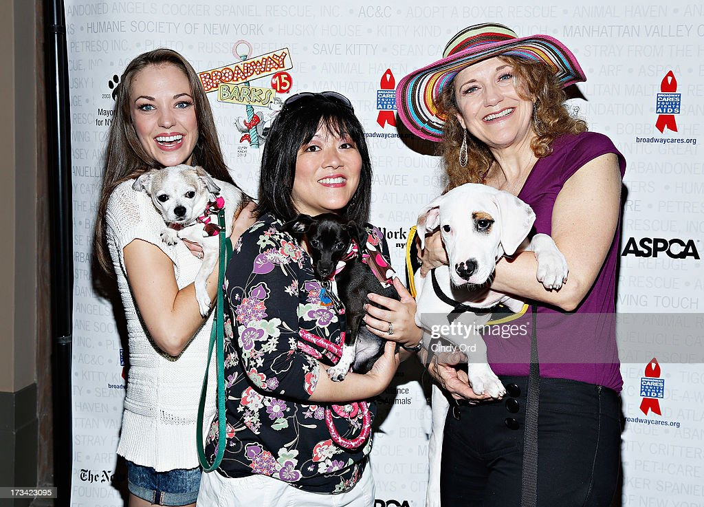 Actresses Laura Osnes, Ann Harada and Victoria Clark attends the Broadway Barks 15th Animal Adoption Event at Shubert Alley on July 13, 2013 in New York City.