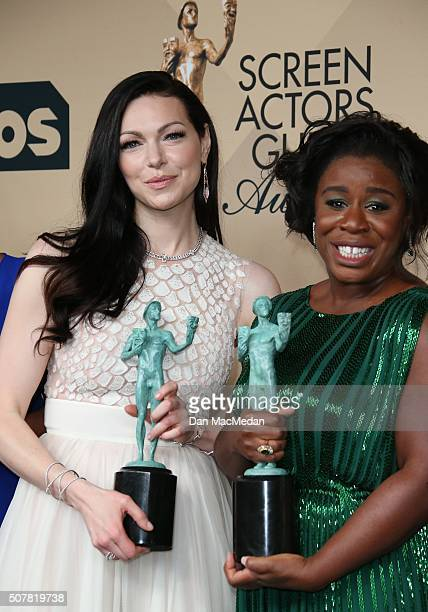 Actresses Laura Prepon and Uzo Aduba winners of Outstanding Performance By a Female in a Comedy Series and Outstanding Performance By An Ensemble in...