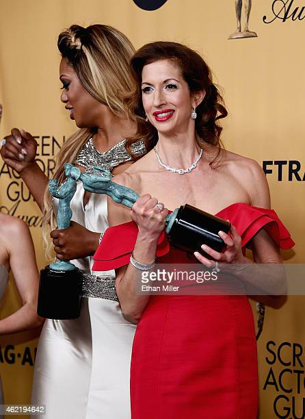 Actresses Laverne Cox and Alysia Reiner winners of Outstanding Performance by an Ensemble in a Comedy Series for 'Orange Is the New Black' pose in...