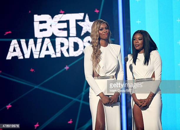 Actresses Laverne Cox and Gabrielle Union speak onstage during the 2015 BET Awards at the Microsoft Theater on June 28 2015 in Los Angeles California