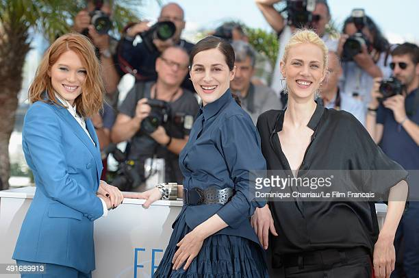 Actresses Lea Seydoux Amira Casar and Aymeline Valade attend the 'Saint Laurent' photocall at the 67th Annual Cannes Film Festival on May 17 2014 in...
