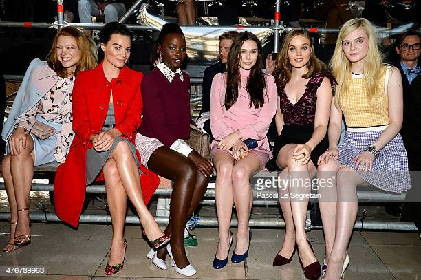 Actresses Lea Seydoux Margot Robbie Lupita Nyong'o Elizabeth Olsen Bella Heathcote and Elle Fanning attend the Miu Miu show as part of the Paris...