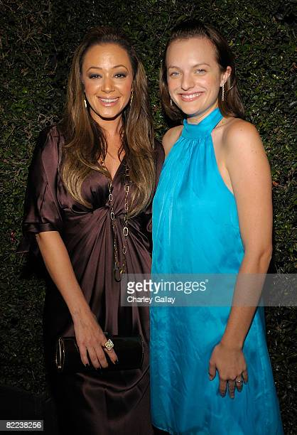 Actresses Leah Remini and Elisabeth Moss pose during the 39th annual Church of Scientology anniversary gala held at The Church of Scientology...