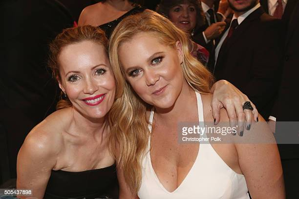 Actresses Leslie Mann and Amy Schumer attend the 21st Annual Critics' Choice Awards at Barker Hangar on January 17 2016 in Santa Monica California