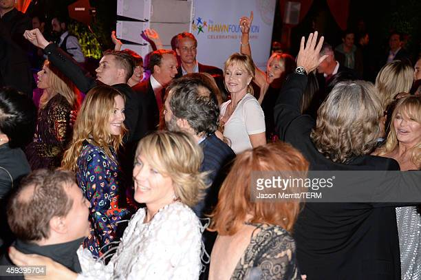 Actresses Leslie Mann and Melanie Griffith dance at Goldie Hawn's inaugural 'Love In For Kids' benefiting the Hawn Foundation's MindUp program...