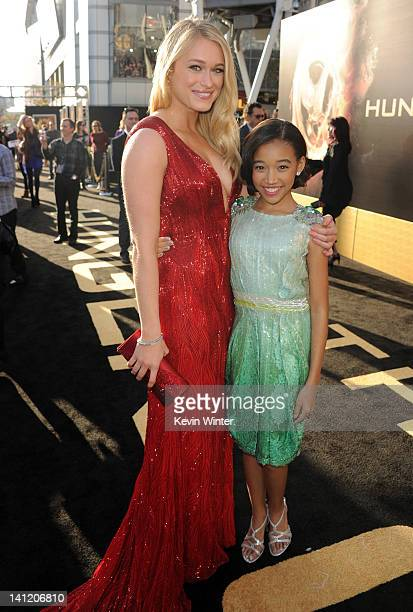 Actresses Leven Rambin and Amandla Stenberg arrive at the premiere of Lionsgate's The Hunger Games at Nokia Theatre LA Live on March 12 2012 in Los...