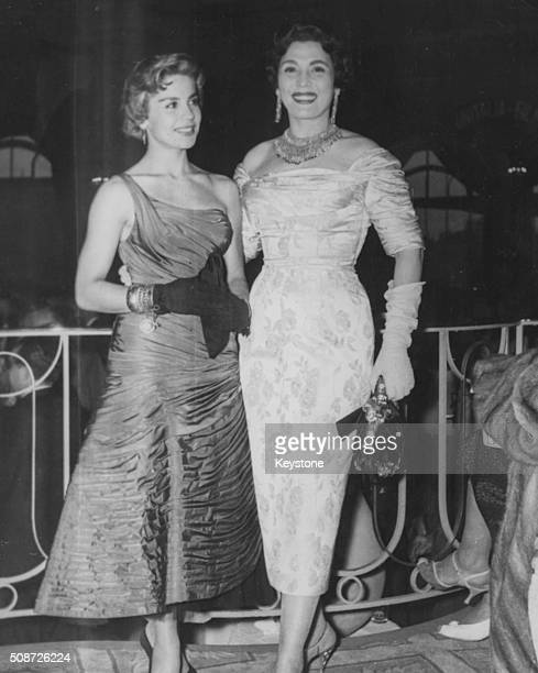 Actresses Lilia Prado and Taheyya Kariokka wearing evening gowns as they attend the Cannes Film Festival France May 1st 1956