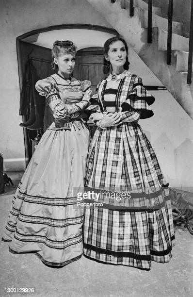 Actresses Lilli Palmer , on left, and Sybille Binder stand together in costume on set to play the roles of Melanie Kurtz and Anne-Marie Kurtz in the...
