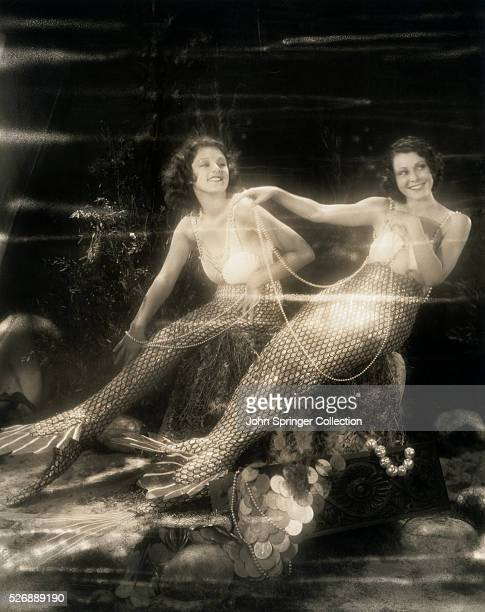 Actresses Lillian Roth and Frances Dee dressed as lovely mermaids of the sea Frances Dee appears opposite Maurice Chevalier in his new production...