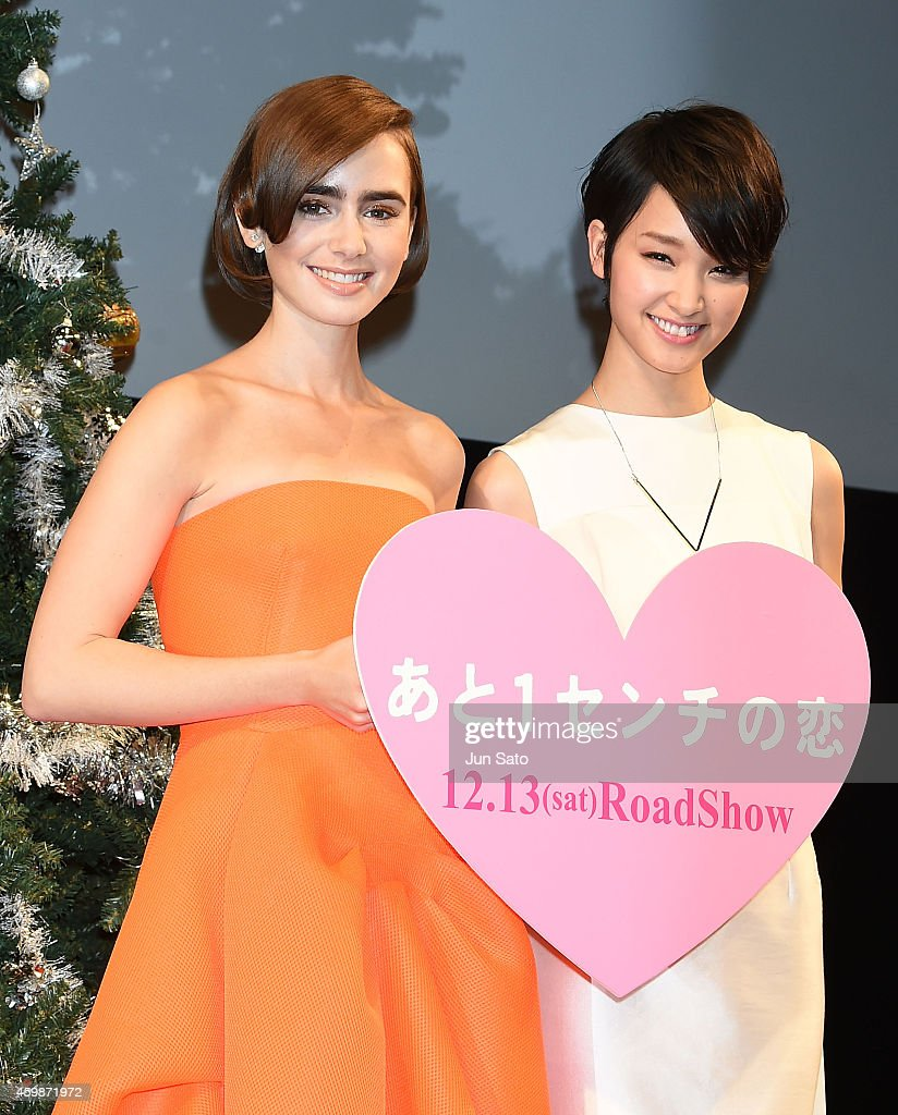 Actresses Lily Collins and Ayame Goriki attend the premiere for 'Love, Rosie' at Harajuku Quest Hall on December 3, 2014 in Tokyo, Japan.