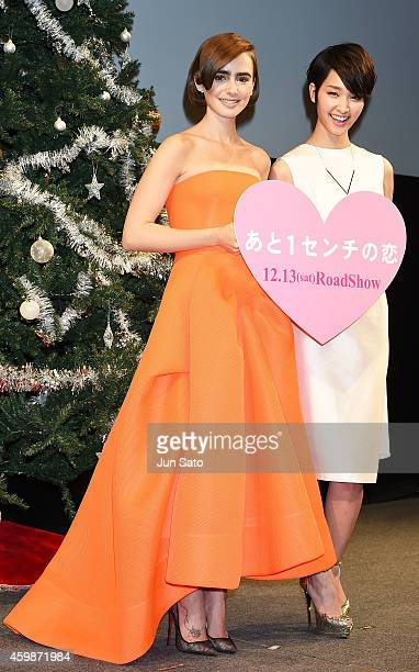 Actresses Lily Collins and Ayame Goriki attend the premiere for Love Rosie at Harajuku Quest Hall on December 3 2014 in Tokyo Japan