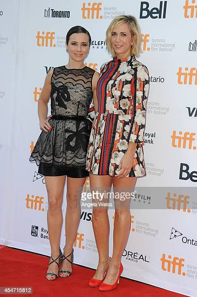 Actresses Linda Cardellini and Kristen Wiig arrive at the 'Welcome To Me' Premiere during the 2014 Toronto International Film Festival at Princess of...