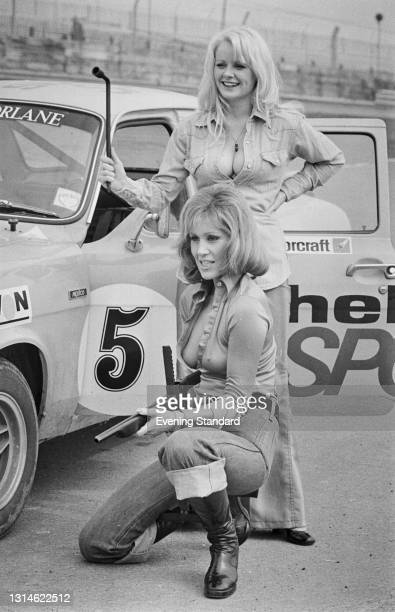 Actresses Linda Cunningham and Fiona Richmond take part in the Shellsport Escort Ladies' Championship at Brands Hatch, UK, 29th March 1974.
