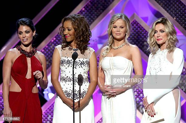 Actresses Lindsay Hartley Chrystee Pharris Crystal Hunt and Donna Mills speak onstage during The 42nd Annual Daytime Emmy Awards at Warner Bros...