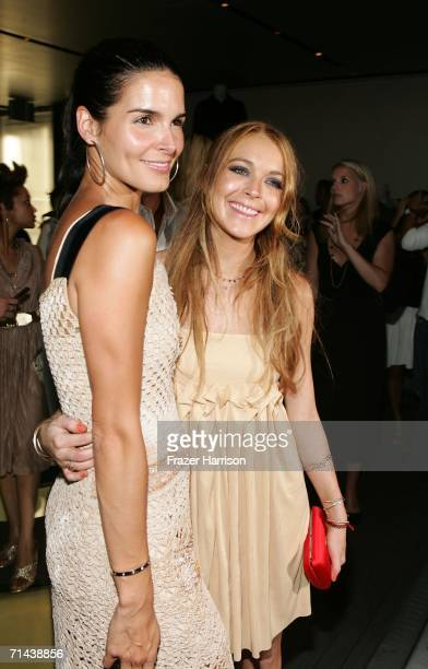 Actresses Lindsay Lohan and Angie Harmon attend the opening of Waist Down Skirts By Miuccia Prada held at Prada on July 13 2006 in Beverly Hills...
