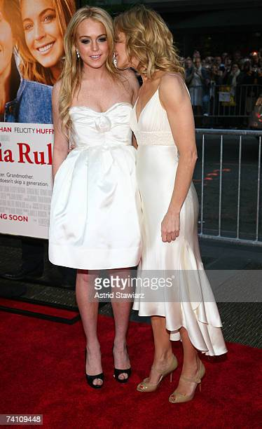 """Actresses Lindsay Lohan and Felicity Huffman whisper to each other at the premiere of """"Georgia Rule"""" at the Ziegfeld on May 8, 2007 in New York City."""