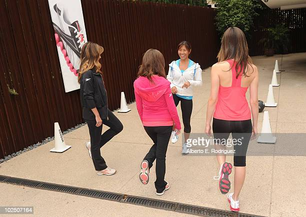 Actresses Lindsay Price Anna Kendrick fitness trainer Yumi Lee and actress Emmy Rossum attend the Reebok Women's Fitness event on June 16 2010 in Los...