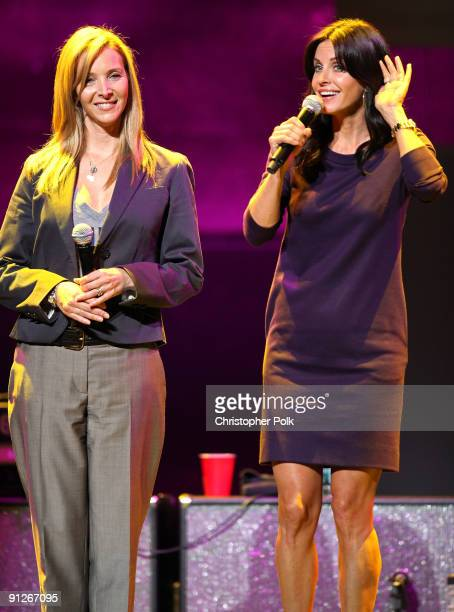 Actresses Lisa Kudrow and Courteney CoxArquette speak onstage during the Rock A Little Feed Alot benefit concert held at Club Nokia on September 29...