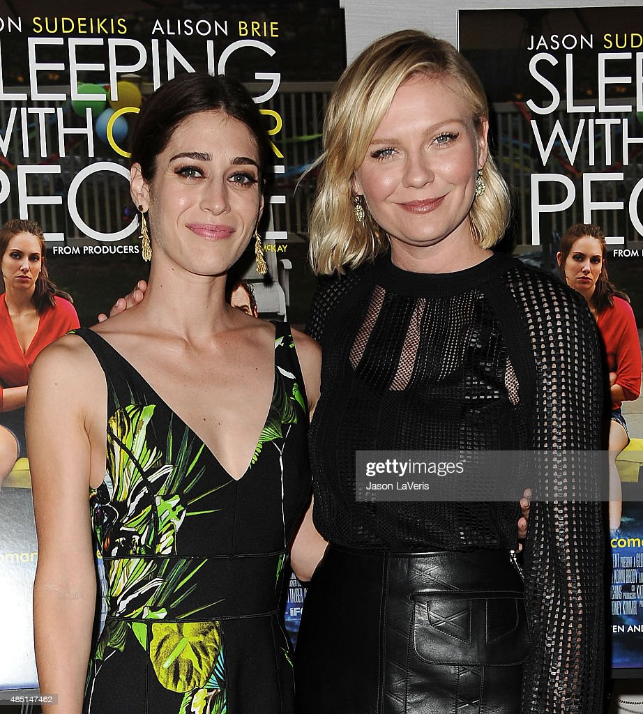 Actresses Lizzy Caplan and Kirsten Dunst attend the tastemaker screening of IFC Films' 'Sleeping With Other People' on August 24, 2015 in West Hollywood, California.