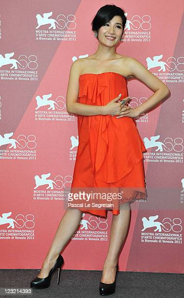 Actresses Lo Meiling poses during the Warriors Of The Rainbow Seediq Bale photocall at the Palazzo Del Cinema during the 68th Venice Film Festival on...