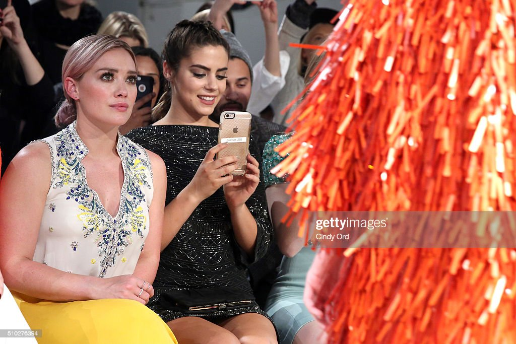 Actresses Lorenza Izzo and Hilary Duff attend the Jenny Packham Fall 2016 fashion show during New York Fashion Week: The Shows at The Gallery, Skylight at Clarkson Sq on February 14, 2016 in New York City.