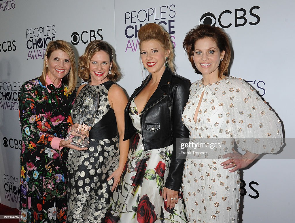 Actresses Lori Loughlin, Andrea Barber, Jodie Sweetin and Candace Cameron Bure, winners of the Favorite Premium Comedy Series Award, 'Fuller House', pose in the press room at the People's Choice Awards 2017 at Microsoft Theater on January 18, 2017 in Los Angeles, California.