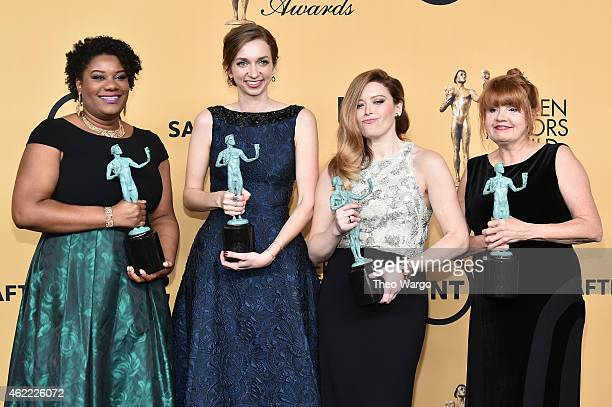 Actresses Lorraine Toussaint Lauren Lapkus Natasha Lyonne and Annie Golden pose in the press room at TNT's 21st Annual Screen Actors Guild Awards at...