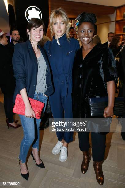 Actresses Louise Monot Pauline Lefevre and Aissa Maiga attend the Montblanc ChampsElysees Flagship Reopening on May 18 2017 in Paris France