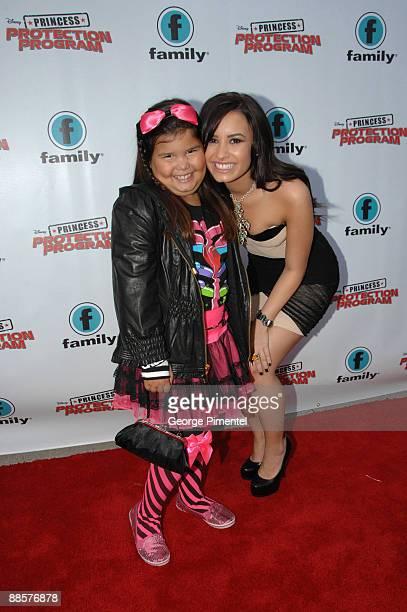 Actresses Madison Delagarza and Demi Lovato attend the Red Carpet Premiere For Disney's 'Princess Protection Program' at the Queen Elizabeth Theatre...