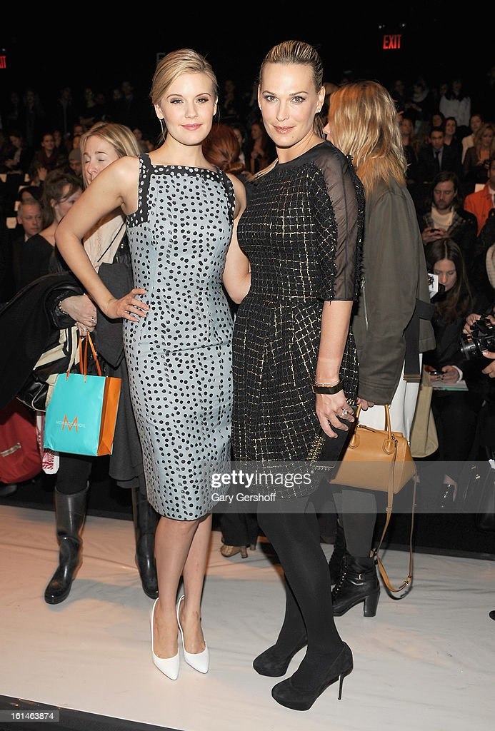 Actresses Maggie Grace (L) and Molly Sims attend the Carolina Herrera fashion show during Fall 2013 Mercedes-Benz Fashion Week at The Theatre at Lincoln Center on February 11, 2013 in New York City.