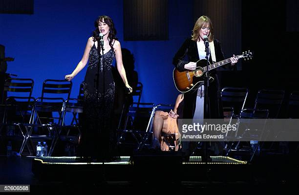 Actresses Maggie Wheeler and Kathleen Wilhoite perform a duet at What a Pair 3 at UCLA's Royce Hall on April 8 2005 in Westwood California Proceeds...