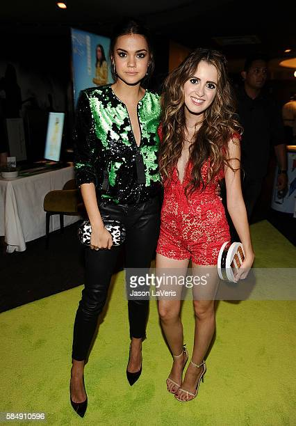 Actresses Maia Mitchell and Laura Marano pose in the green room at the 2016 Teen Choice Awards at The Forum on July 31 2016 in Inglewood California