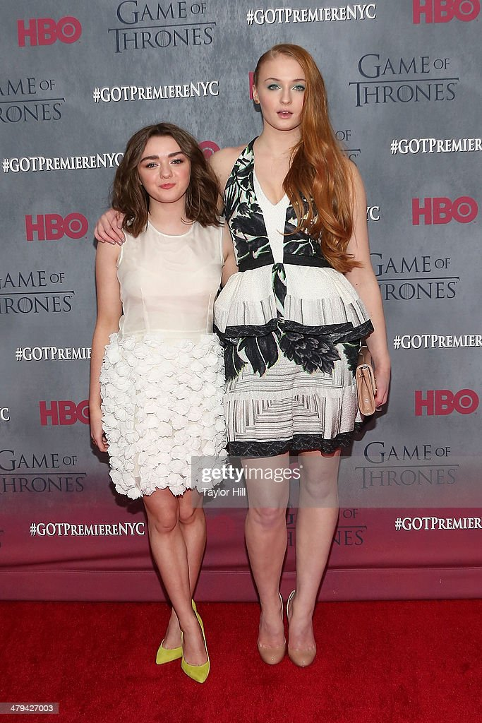 Actresses Maisie Williams and Sophie Turner attend the 'Game Of Thrones' Season 4 premiere at Avery Fisher Hall, Lincoln Center on March 18, 2014 in New York City.