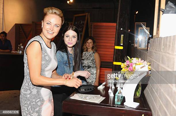Actresses Malin Akerman and Michelle Trachtenberg shopping Stella and Bow jewelry attends The Launch of Parker on Spring at The A List on September...