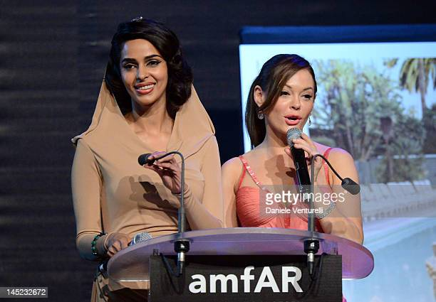 Actresses Mallika Sherawat and Rose McGowan speak at the 2012 amfAR's Cinema Against AIDS during the 65th Annual Cannes Film Festival at Hotel Du Cap...