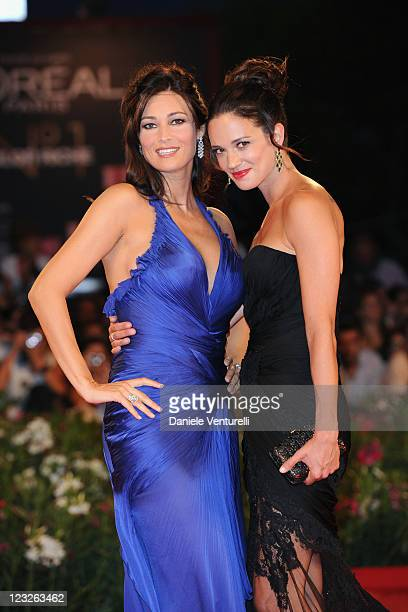 Actresses Manuela Arcuri and Asia Argento attend the Carnage premiere during the 68th Venice International Film Festival at Palazzo del Cinema on...